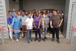 OSI Electronics UK - employees cutting the ribbon on 24th August 2018 to open the new production block in St-Neots, Cambridgeshire. Together with the main unit a few yards away, production space is some 70,000 sq-ft