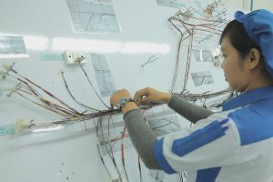 High reliability cable and wire harness assembly at OSI Electronics' facility in Batam, Indonesia.