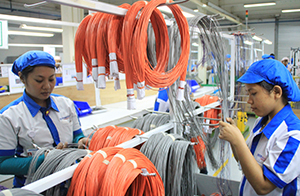 Complex harness assemblies at OSI Electronics' facility in Batam, Indonesia.